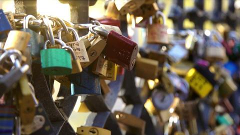 Girl hang a padlock of love Filmmaterial