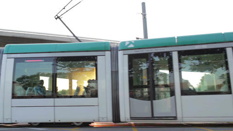 Tram is passing by at sunset Stock Video Footage