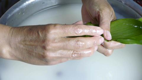 Hands produced rice dumplings of Jujube & glutinous rice Stock Video Footage