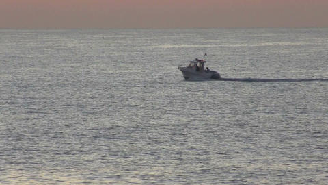 Motor boat sailing on the sea at dawn Live Action