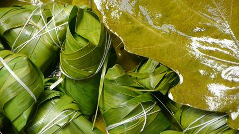 Rotation of rice dumplings of glutinous rice,dumplings leaf Stock Video Footage