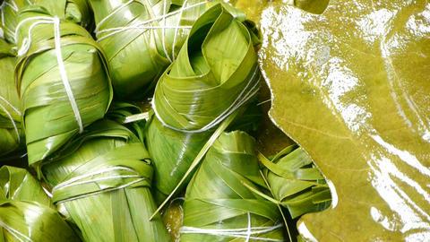 Rotation of rice dumplings of glutinous rice,dumplings leaf Footage