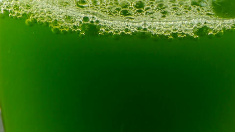A cup of green wort,wheat-juice,blisters in glass Stock Video Footage