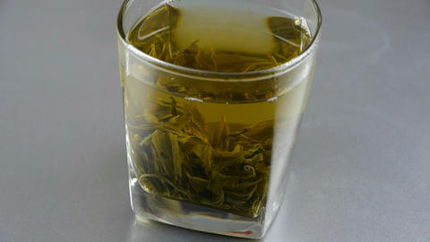 A cup of green tea Stock Video Footage