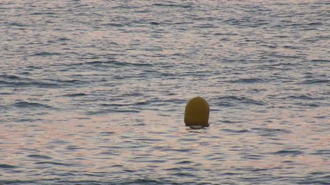 Yellow Buoy bobs on the waves, closeup Stock Video Footage
