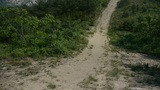 Dirt road leading to the hilltop,steep-rock,Cliff top of the hill Footage