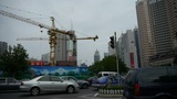 Urban intersection street,Busy people,crane tower-cranes,construction Footage