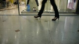 Pedestrian footsteps in the mall before the showcase window Footage