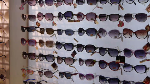 entire wall of sunglasses at the mall Stock Video Footage