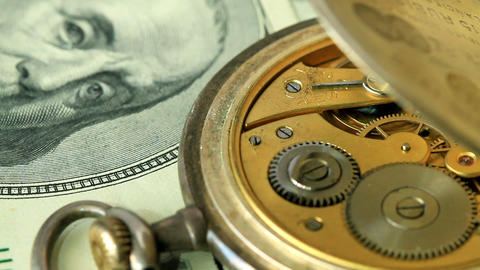 dollar and the old pendulum clock. loopable Stock Video Footage