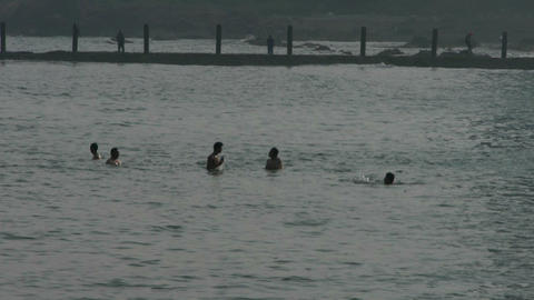 People swimming in the ocean,relying on dams Stock Video Footage