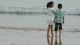 Siblings Child Play At Sand Beach.tide,tidal stock footage