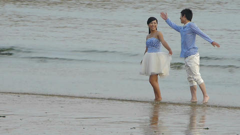 The happy couple at beach.tide,tidal Footage