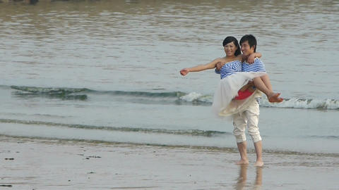 The happy couple at beach.Men picked up woman.tide,tidal Stock Video Footage