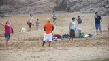 international visitors playing beach volleyball On beach Footage