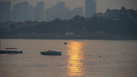 Dusk waterfront.Ship boat on the sea,horizon is high-rise... Stock Video Footage