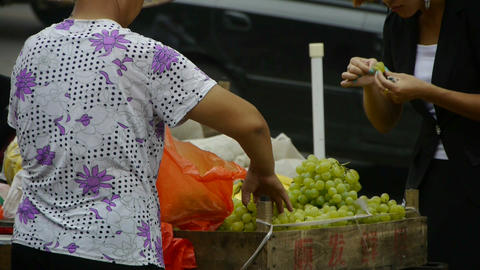 China town fairs market,selling grapes fruit Stock Video Footage