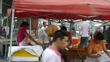roadside snack bar cooking,China town fairs market,selling fritters,crowded stre Footage