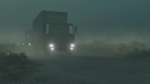 Military trucks convoy on a dirt road at night Footage