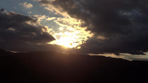 Heavy clouds gathering storm over a wooded hill to watch the evening Footage