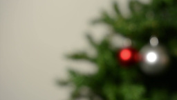 Decorating the Christmas tree with decorative balls - white backgroung. Blurred  Footage