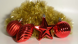 Christmas Decoration - red ornaments with gold chain - white background Footage