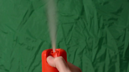 hand (young man) uses toilet spray (air freshener) - (green screen) Footage