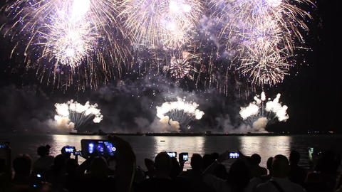 people with smartphones watching fireworks Footage