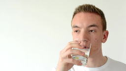 man drinks water and smiles - isolated Footage