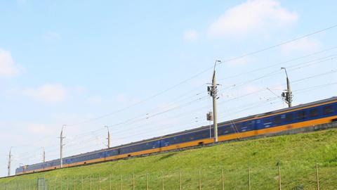 Intercity train of the Dutch Railways (NS- Nederlandse Spoorwegen) passing