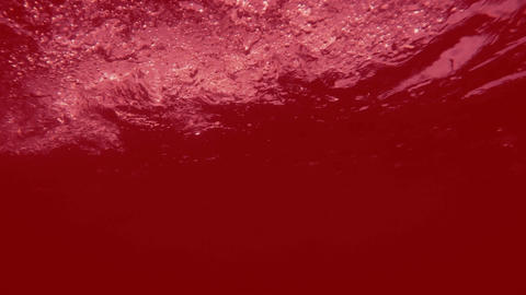 Abstract red liquid in motion - turbulence with bubbles Footage