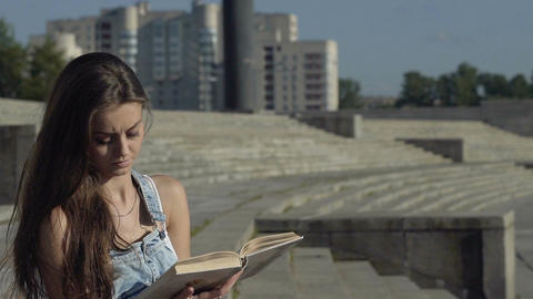Woman Concentrated Reading Book Footage