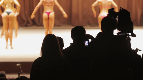 Operator filming bodybuilding contest and reporters waiting for interview Footage