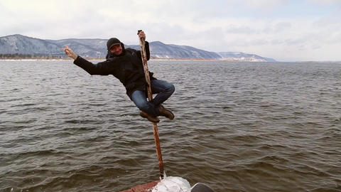 Funny man climbed up the pole Footage