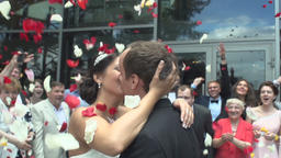 Groom Holds Bride While Kiss In The Crowd Of Guests Footage