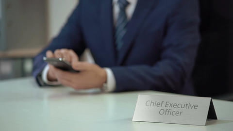 Male chief executive officer using smartphone, reading business news online Footage