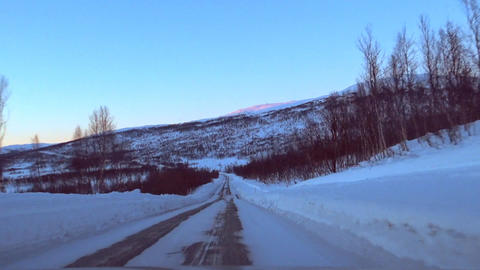 Driving on an icy road on the island Senja in Northern Norway Footage