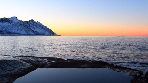 Sunset over the Ersfjord mountain range at the island of Senja in Northern Norwa Footage