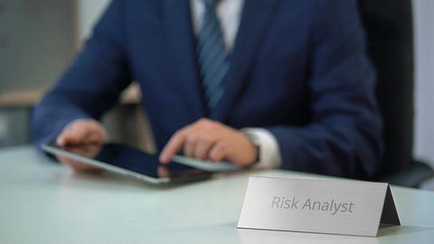 Risk analyst reading market report on tablet pc, checking... Stock Video Footage