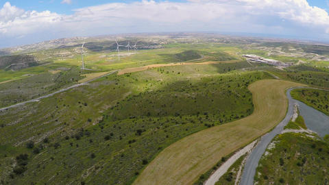 Amazing green landscape, wind turbines generating power, nature conservation Footage