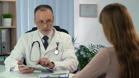 Doctor typing patient's personal data on tablet, modern technologies in medicine Footage