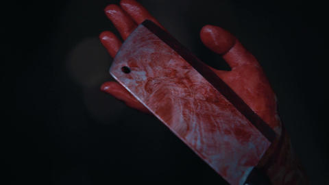 Killer's hands shaking with fear and holding murder weapon, butcher knife Live Action