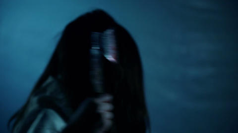 Creepy crime, cruel female maniac killing someone with ax, nightmarish scene Footage