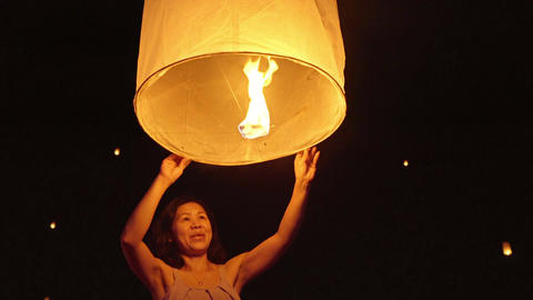 Cute Asian Woman Releasing A Sky Lantern Live Action