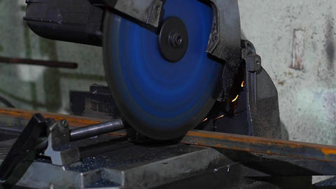 Worker Cutting Iron with a Metal Cutting Chop Live Action