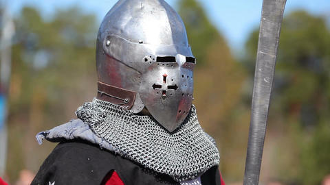Close-up of a knight in armor is preparing for battle Footage