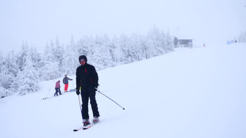 Family skiing. Winter mountain slope for downhill skiing in ski resort in terrib Footage