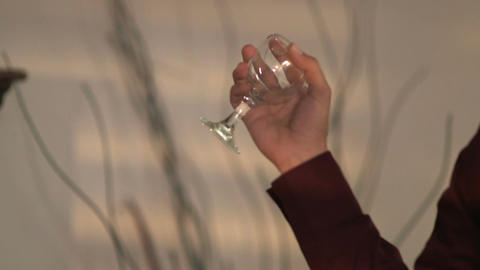 Man throws wine glass from his hand Footage