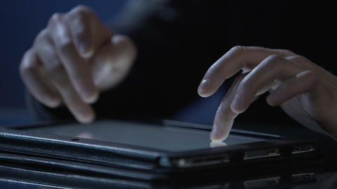 System administrator using tablet to maintain computer network, hands close-up Footage