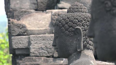 Statue of meditating Buddha. Ancient Borobudur Buddhist temple. Java Indonesia Footage